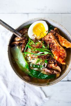 Simple Spicy Miso Ramen w/ Roasted Chili Salmon ( or tofu!) with bok choy, mushrooms and scallions. Vegan and Paleo adaptable! Swap out zucchini noodles or kelp noodles to keep it Paleo! Make in 20 minutes!   www.feastingathome.com