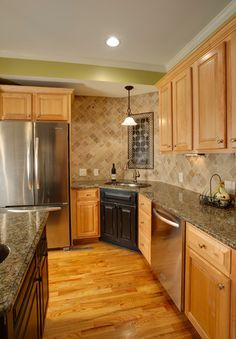 The new flooring resembles backsplash in the photo and am going to refinish  my existing maple cabinets so this
