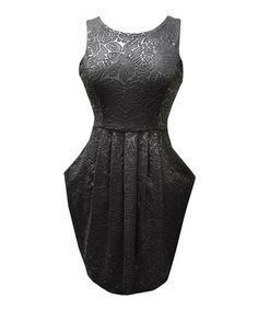 This classic, romantic dress features luxe texture and formfitting style with a sweet tie in the back for a final element of fashion fantasy.