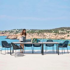 This is a contemporary outdoor dining table which can add a sophisticated touch to your outdoor design.