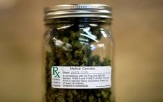 A jar of medical marijuana is displayed at the medical marijuana farmers market at the California Heritage Market in Los Angeles, California July 11, 2014. The first-ever cannabis farmer's market in Los Angeles began on July 4 and opens weekly from Friday to Sunday.