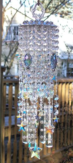 This dazzling wind chime is custom designed using an antique brass scalloped, cut~out, heavily embossed lighting component that I painted