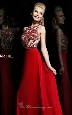 Look flawless on your special event with Sherri Hill11069. This luxurious evening gown showcases a scoop neckline sleeveless top. Shimmering beads cover the entire bodice. The slim skirt is cut at floor length hem with train.