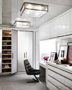 A Vladimir Kagan chair upholstered in an Edelman leather and ceiling fixtures by Remains Lighting in the dressing room; the cabinetry is custom made, and the carpet is by Holland & Sherry.