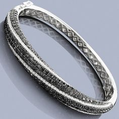 Unique Black Diamond Jewelry: This 14K Ladies Bangle Bracelet weighs approximately 22 grams and showcases 6.05 carats of dazzling white and black diamonds. Featuring an intricate 3-D design and a highly polished gold finish, this women's diamond bangle bracelet is available in 14K white, yellow and rose gold.