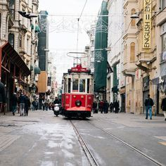 The historical İstiklal Caddesi tram in Istanbul Turkey. Driving through a big shopping street in the heart of the city that is built on two continents (Asia & Europe)