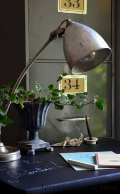 Industrial, urban loft Vintage file cabinet. Decorating with numbers. black urn. Greenery
