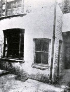 Photograph of Mary Kelly's rented room in Miller's Court. It is altogether probable that this picture was taken the morning of the murder - before the police had it boarded over.