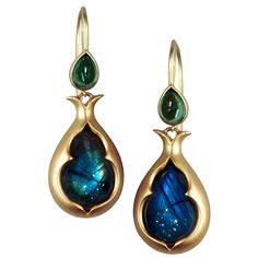 Anahita Labradorite Green Tourmaline Gold Motif Drop Earrings. Motif Drop Earrings handcrafted in matte-finished 18k yellow gold with two stunning pear-shaped cabochon-cut labradorite drops and accents with two pear-shaped cabochon-cut green tourmalines. c 2015