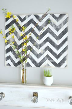 Chevron mantel with Forsythia!