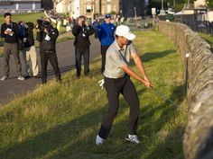 Jordan Spieth plays a shot against the wall at the 17th Road Hole during a practice round for the 144th Open Championship at Royal and Ancient Golf Club of St Andrews, Scotland.  Ian Rutherford, USA TODAY Sports