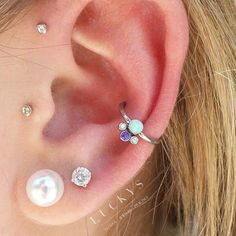 fresh conch piercing with a sweet little opal cluster. Conch Ring, Conch Jewelry, Body Jewelry, Fine Jewelry, Jewellery, Tragus, Cartilage Piercings, Cartilage Earrings, Gauges