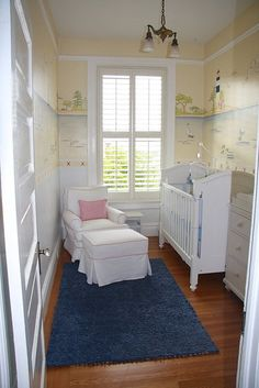 Tiny, yet adorable nursery (maybe without the wallpaper). and I'd have a Glider!