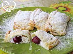 Saccottini con ricotta e ciliegie http://www.cuocaperpassione.it/ricetta/b2201f4c-9f72-6375-b10c-ff0000780917/Saccottini_con_ricotta_e_ciliegie