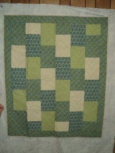 neat rectangle quilt idea perhaps with some brighter fabrics!