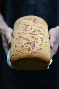 Jalapeno Cheddar Bread  1 medium loaf    Ingredients:  3/4 water plus 3 tbls  1/4 cup canola oil  1 egg, room temperature  1 1/2 tsps salt  2 tbls sugar  1/2 cup yellow corn meal, I used medium  1/2 cup yellow cheddar, shredded  1/2 cup white cheddar, shredded  2 tbls diced jalapeno (1 large)  3 cups bread flour   2 1/2 tsps active dry yeast (1 1/4oz packet)  Oil for coating and brushing