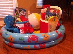 I like the blow up pool for a basket container Beach fundraiser basket Fundraiser Baskets, Raffle Baskets, Creative Gifts, Cool Gifts, Diy Gifts, Auction Donations, Chinese Auction, Silent Auction Baskets, Beach Basket