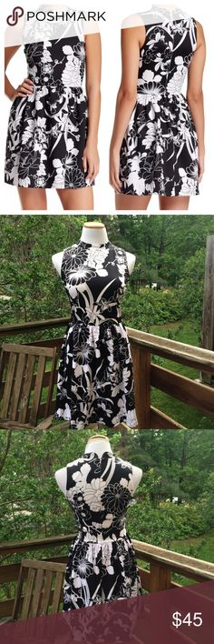 Just In! Black & White Floral Fit & Flare Stretchy black dress with white floral pattern. New with tags. Super flattering Scuba type material that is soft and stretchy. Hits above the knee. Love ady Dresses Mini