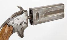 Percussion operated rotating barrel pistol. Single shot. Age unknown