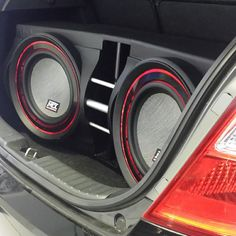 Thunder 8000 series subwoofers with custom red accents in a rear-firing ported enclosure.