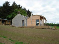 This curved roof Barn Shape is used throughout Ireland: it seems to me any authentic extension needs to make use of it