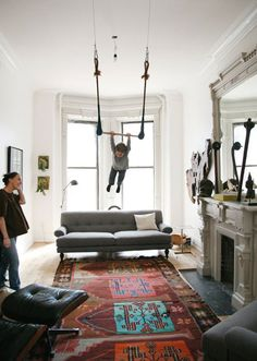Love the rug!  Oh, and I neeeeed a trapeze in my living room. (via covet garden - blog - Kilim Me Softly)