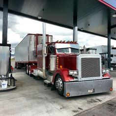 Lookin' large.... a nice Pete with matching reefer trailer at the pumps.