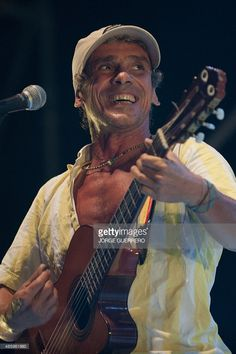 French musician Manu Chao performs on stage during a concert in Frigiliana on August 30, 2015.