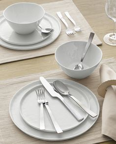 "Contemporary porcelain whiteware represents a fusion of refinement and rusticity. Round slim profile takes on organic overtones with freeform rims and a finely ""hammered"" surface that ripples the light."