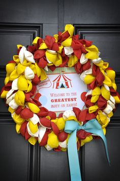 Great wreath! Make a wreath out of uninflated party balloons. So cheap and easy! Merely change the sign in the middle each time you use it to reflect the event: birthday, graduation, retirement, bridal shower, baby shower