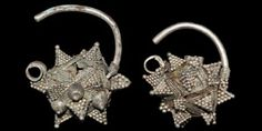 BYZANTINE EARRING PAIR 7th-10th century AD  A matched pair of earrings, each with round-section shank, polyhedral body with multiple strands of ropework enclosing triangular panels, loop to the underside, pyramids of granulation attached to panels; one earring with a hole to the rear. 20 grams total, 31mm