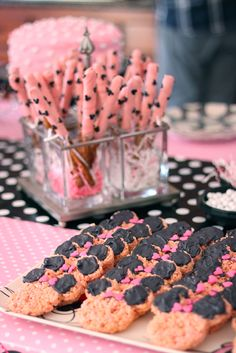 Minnie Mouse party food - dipped pretzel sticks and Rice Krispie treats