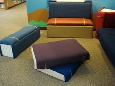 Book-shaped floor cushions. Super cool for bibliophiles, like us!