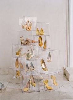Shoe storage (and/or display) in clear acrylic cubes.