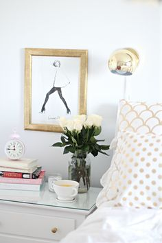 white & gold themed bedside table