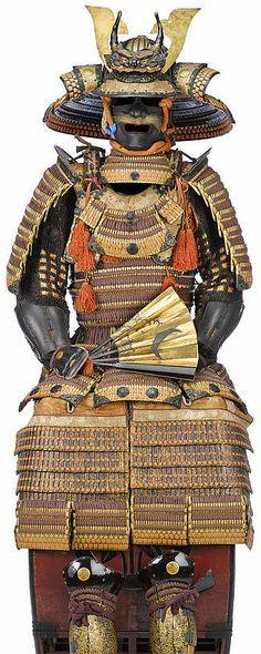 "24 ken suji bachi kabuto, hon kin kozane, haramaki dou gusoku, Edo period, 18th c, kabuto signed ""Masanobu"", oni maedate, russet-iron menpo , nodawa attached with stenciled doeskin, haramaki dou with a back plate and fitted with eight sections of five-lame kusazuri, kyudan no ita and sendan no ita, large tsubo sode, russet-iron tsubo gote, kawara haidate with six sections of additional lames, tsubo suneate finished in gold and black lacquered leather."