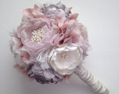 This beautiful bouquet contains handmade fabric flowers in pure white satin and pale pink chiffon. Centers of each flower are finished with