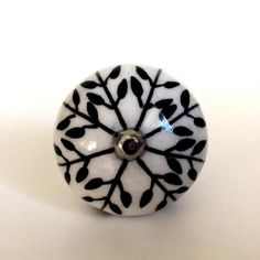 Sophisticated and stylish. A fabulous finishing touch, perfect for creating a unique look. Hand-painted black leaf porcelain cabinet knobs drawer pulls.