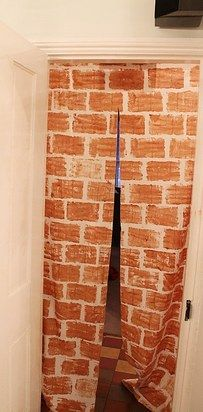 An old sheet becomes a brick wall entrance. | 33 Cheap And Easy Ways To Throw An Epic Harry Potter Halloween Party