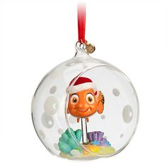 "New .   Nemo is fully sculptured inside the open picture window glass globe.  Glitter accents and base.  Flocked hat.  Satin Ribbon for hanging.  Resin/Glass  3"" H"