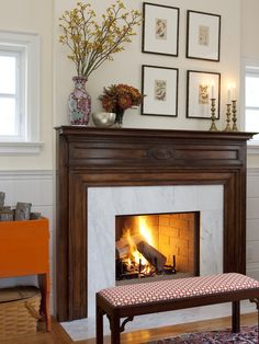 Take a cue from designer Sarah Richardson and give a traditional living room updated style with frames hung asymmetrically above the fireplace. Tall branches in an Oriental vase to the left of the frames fill the void and create balance. Bedroom Fireplace, Fireplace Design, Farmhouse Fireplace, Fireplace Mantels, Mantles, Fireplace Ideas, Mantel Ideas, Fireplace Remodel, Fireplace Wall