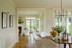 the wall paint is Benjamin Moore 'Bone' in eggshell and the trim is all 'Linen White' semi-gloss.
