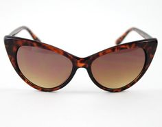 These fierce Pin Up shades are dying to be paired with a headscarf and vintage Mustang! $16 www.mooreaseal.com