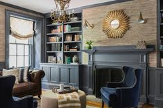 Deep gray painted woodwork gives drama to this family room by designer Erin Gates. Her favorite neutral color is Benjamin Moore Balboa Mist.