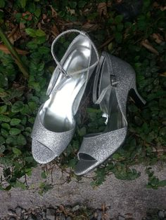 Silver glitter peep toe ankle strap.