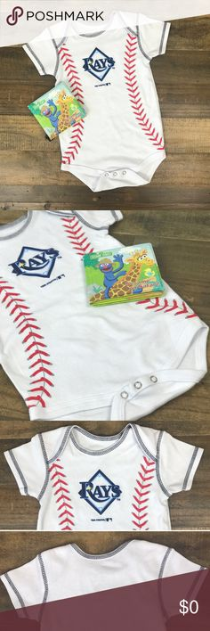 NWOT, Tampa Bay Rays 18Month Onesie  DETAILS: NWOT genuine merchandise. Has a tiny dot shown above in the last picture. Snaps at the bottom. Never worn.                                                                 COLORS: white, dark & light blue, red & grey.              LENGTH (neck to bottom): about 14 inches.                     CHEST WIDTH: about 10 inches.                                                               I would ❤️ to answer any questions. If this is perfect for your…