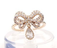 Gift Wrapping Bow dangling ring detailed with CZ
