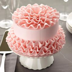 "Candy Frills Cake - All ruffled and ready to go, this cake is perfect for a princess party or a bridal shower. Just shape the candy clay ruffles with your fingers and attach around the cake to experience that ""wow"" moment."