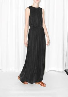 Made from luxurious cupro fabric with a light and velvety sheen, this sleeveless maxi dress has a seductive V-cut in the back.