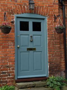 Brick cottage, cottage front doors, grey front doors, house front d Cottage Front Doors, Brick Cottage, Grey Front Doors, House Front Door, Painted Front Doors, House Doors, Garage Doors, Exterior Door Colors, Exterior Doors